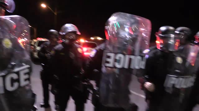 a356c396c5 Protesters clash with police after rally in downtown Phoenix