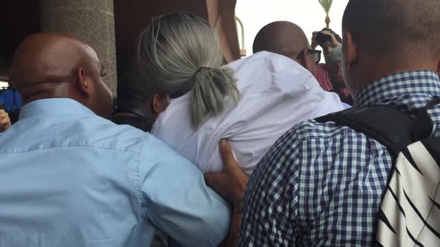 Dalvin Hollins' grandmother carried by family during march on Tempe bridge