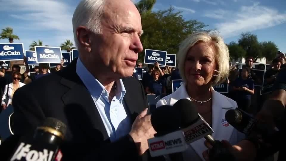 Sen. John McCain and Cindy McCain talk to media after voting