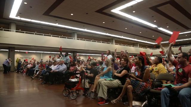 Town Hall chants 'Shame on you' to Sen. Flake