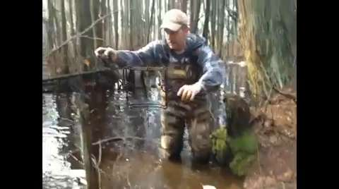 A local trapper locates a large beaver lodge in Jackson, N.J. IPHONE VIDEO BY DAN RADEL