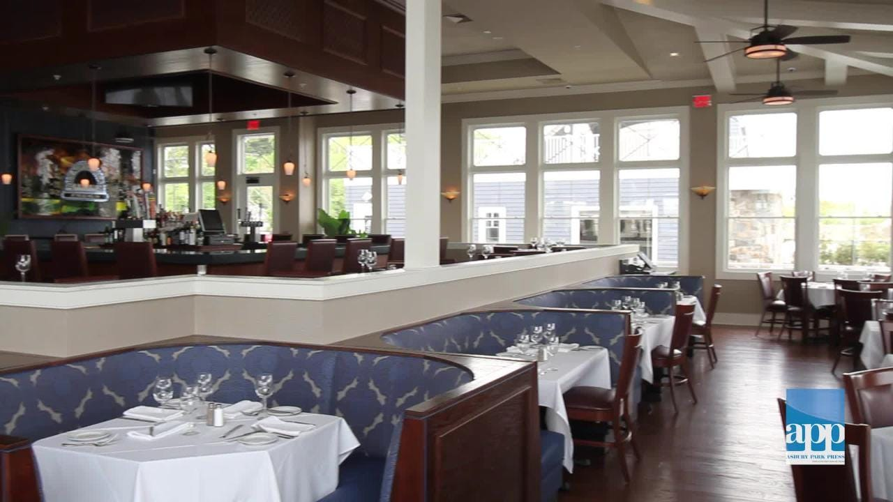 Joe Amiel gives a tour of his waterfront restaurant, Bay Pointe Inn, in Highlands.