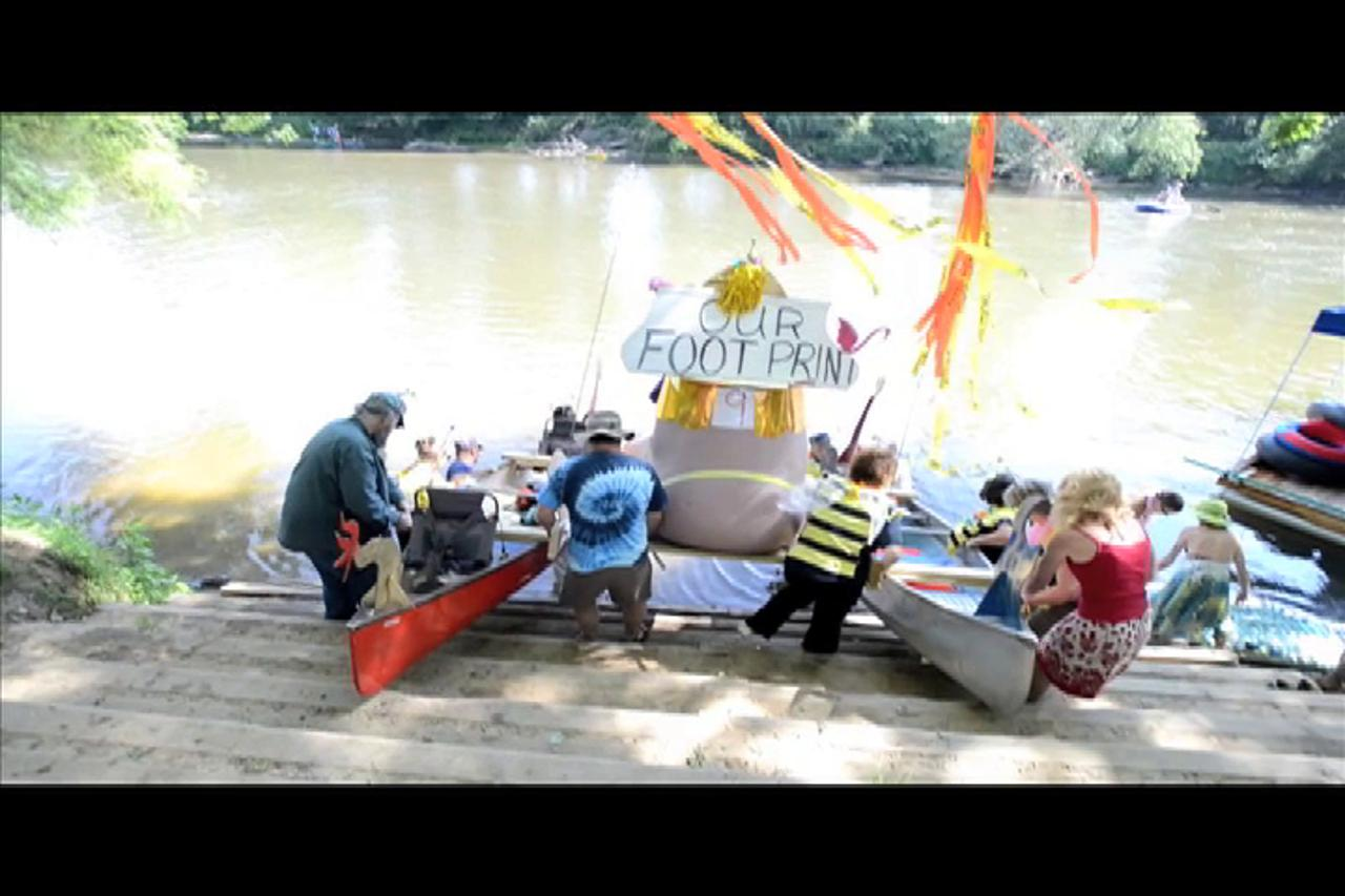 The 2015 Anything That Floats boat race featured boats decorated with a theme, which were paraded down the French Broad River past the RiverFest celebration at French Broad Park off Amboy Road.