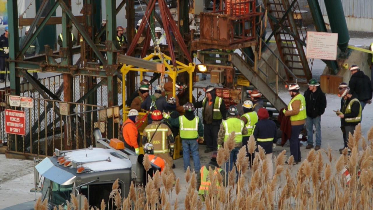 Cargill salt mine workers, some of whom who spent up to 10 hours stuck in a elevator 900 feet below the surface, are rescued using a basket and crane Thursday, Jan. 7, 2016 in Lansing New York.