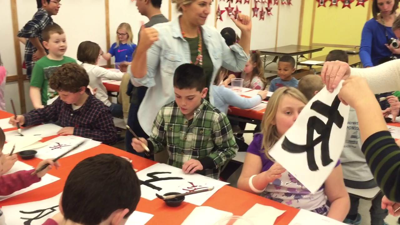 Students from Nakagawa, Japan teach children at Ridge Road Elementary School in Horseheads how to write Japanese characters during a school visit in March.