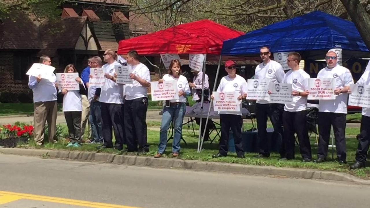 Correction officers at the Elmira Correctional Facility gather across the street from the prison in 2016 to protest what they claim are unsafe working conditions.