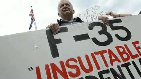 Opponents to F35 in Vermont rally on Church Street
