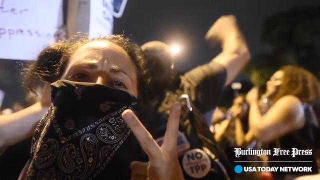 Protesters protect police on the last day of the DNC in Philadelphia