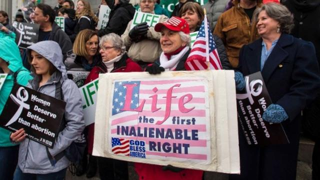 About 350 people gathered behind City Hall in Montpelier Saturday, Jan. 21, 2017 for the annual Right to Life march to the Statehouse. Photos by Glenn Russell, Free Press.