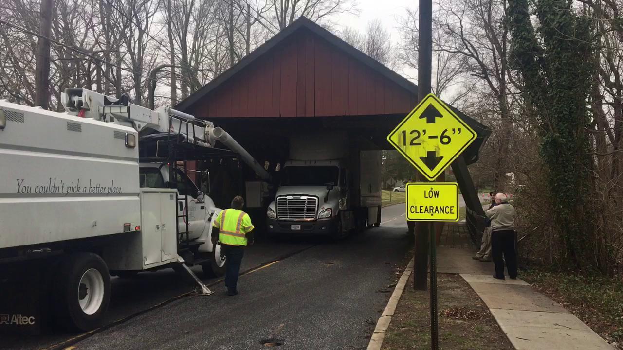 WATCH: Truck gets stuck under Cherry Hill bridge