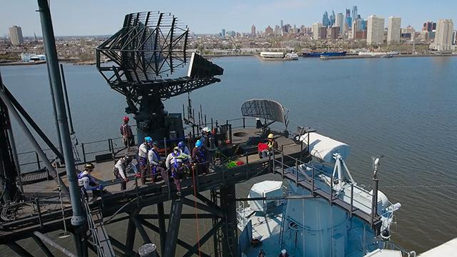 WATCH: Rescuers scale battleship in Camden