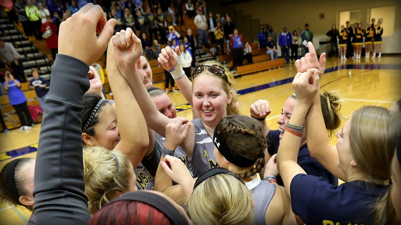 "Battling DIPG, a rare and agressive brain cancer, Lauren Hill scored in her first official home game. ""I believe God has the last say,"" said the Mount Saint Joseph freshman."