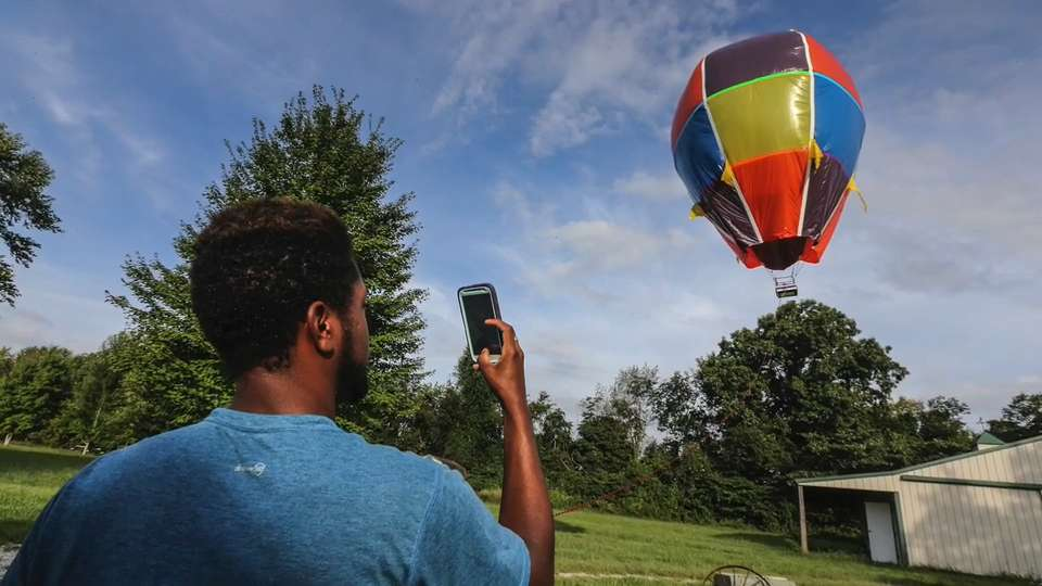 Creating hot air balloons from trash bags, duct tape | Video