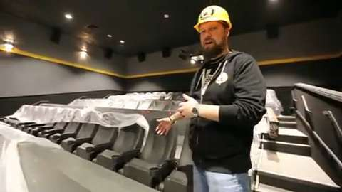 Greg Johnson, director of Marketing for Flix Brewhouse, gives a sneak preview of the nearly complete Flix Brewhouse in Des Moines' Merle Hay Mall.