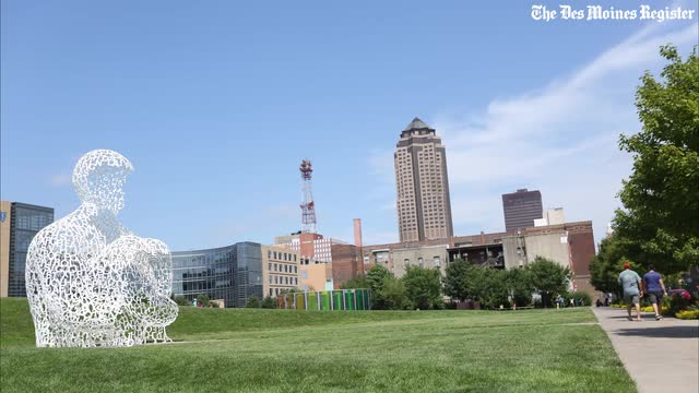 Selfie takers, Pokemon Go players and dog walkers spend a typical Sunday in Des Moines at the Pappajohn Sculpture Park on Sunday, July 17, 2016.