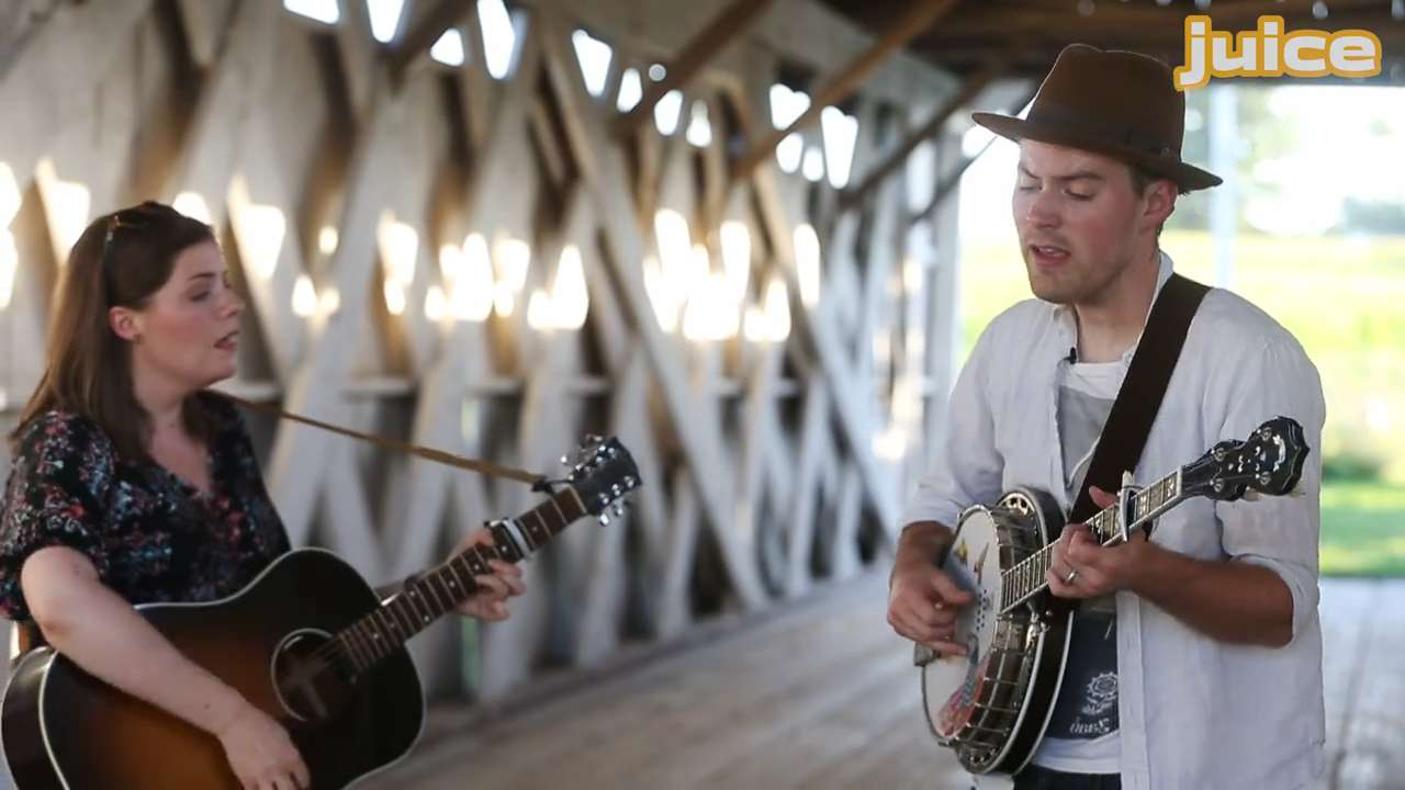 """Folk/Pop duo Bryan and Sarah Vanderpool perform their song """"Drive"""" at the Imes Covered Bridge, one of the famed Bridges of Madison County, in St. Charles, Iowa."""