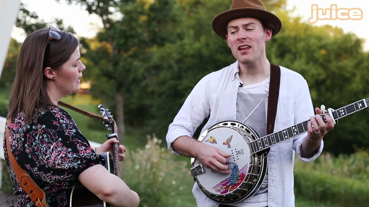 """Folk/Pop duo Bryan and Sarah Vanderpool perform their song """"Worldshaker"""" at the Imes Covered Bridge, one of the famed Bridges of Madison County, in St. Charles, Iowa."""