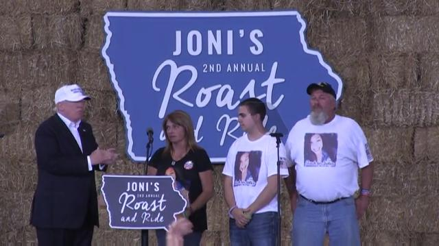 Republican presidential nominee Donald Trump welcomes the family of Sarah Root, who was killed by immigrant in the United States illegally, onto the stage at Joni Ernst's Roast and Ride Aug. 27, 2016.
