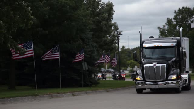 The Wall That Heals, a replica of the Vietnam Veterans Wall Memorial in Washington D.C., arrives with a motorcycle motorcade at Living History Farms on Sept. 28. Linh Ta/The Register