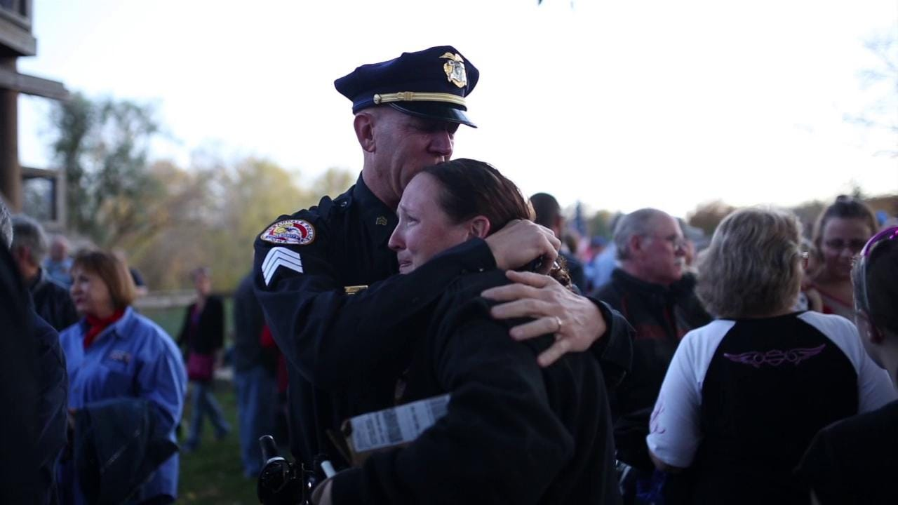 """More than 2,000 people gathered Friday night in Urbandale to mourn the shooting deaths of Urbandale Police Officer Justin Martin and Des Moines Police Sgt. Anthony """"Tony"""" Beminio."""