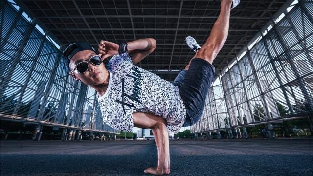 """Zach Benson was born in South Korea and raised in Iowa. He's now a """"digital nomad"""" who, within his first decade after college, has built a life and career around his passion for dance and his own social media firm."""