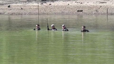 Evansdale girls: FBI dive team searches Meyers Lake