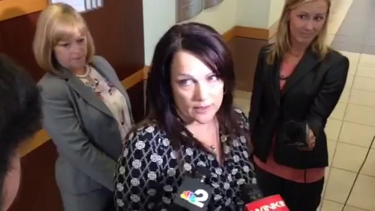 Annie Lisa, sister of Dr. Teresa Sievers, speaks with reporters.