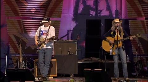 "Emmylou Harris performs her hit ""Red Dirt Girl"" at a Farm Aid show."
