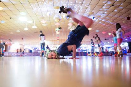Parents take their kids to Skateland USA as an alternative summer activity and a good way to beat the heat.
