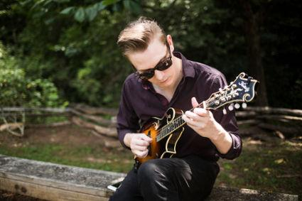 """Caleb Hanks of the band Nitrograss plays """"Fisher's Horn Pipe"""" on mandolin at the Banjo Extravaganza at Hagood Mill on Saturday, July 16, 2016 in Pickens."""