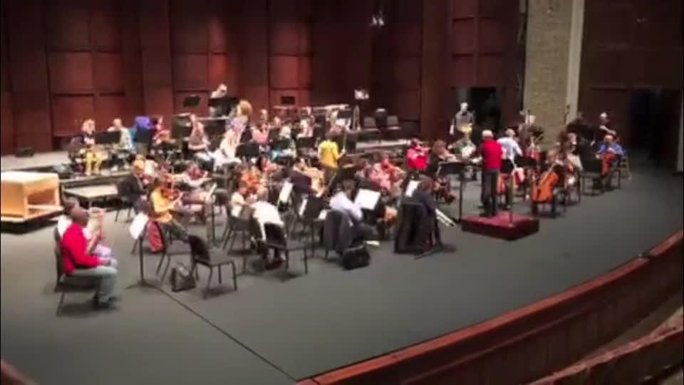 The Greenville Symphony Orchestra arrives for practice.