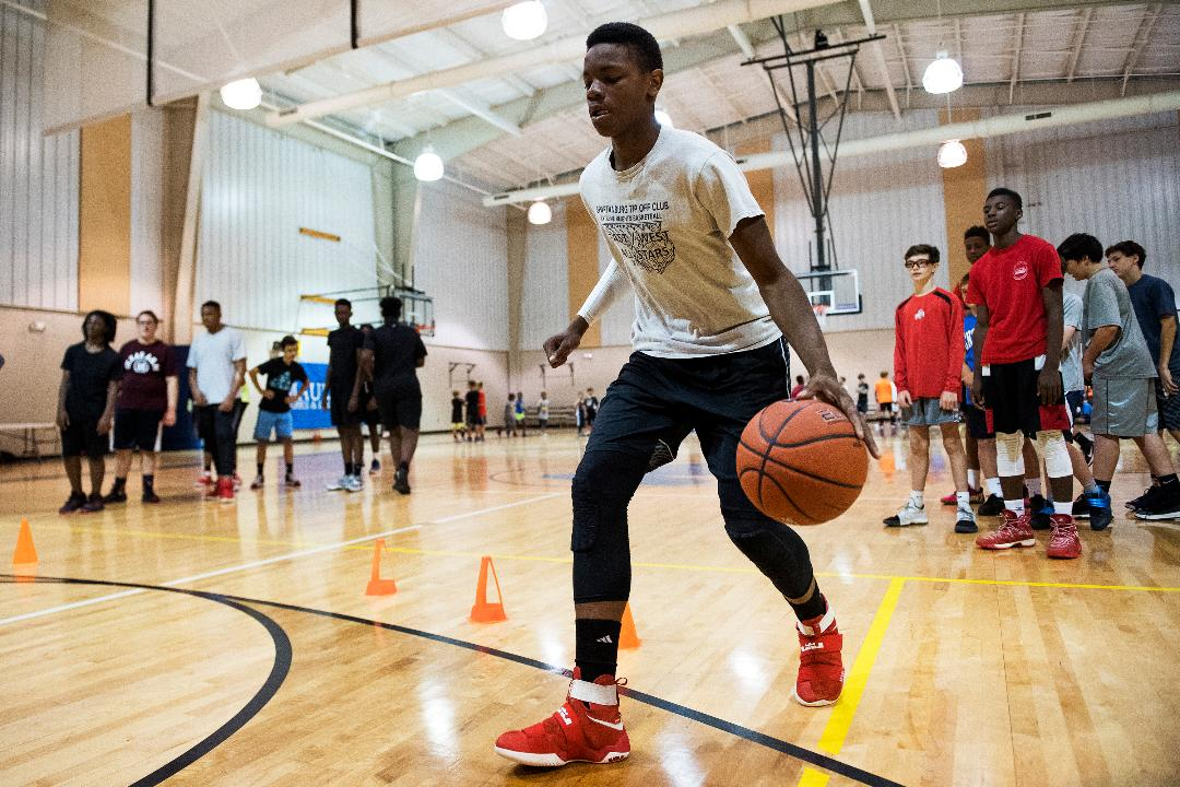 john wall talks to young players at mauldin basketball camp