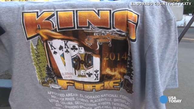 Vendors selling King Fire memorabilia t-shirts