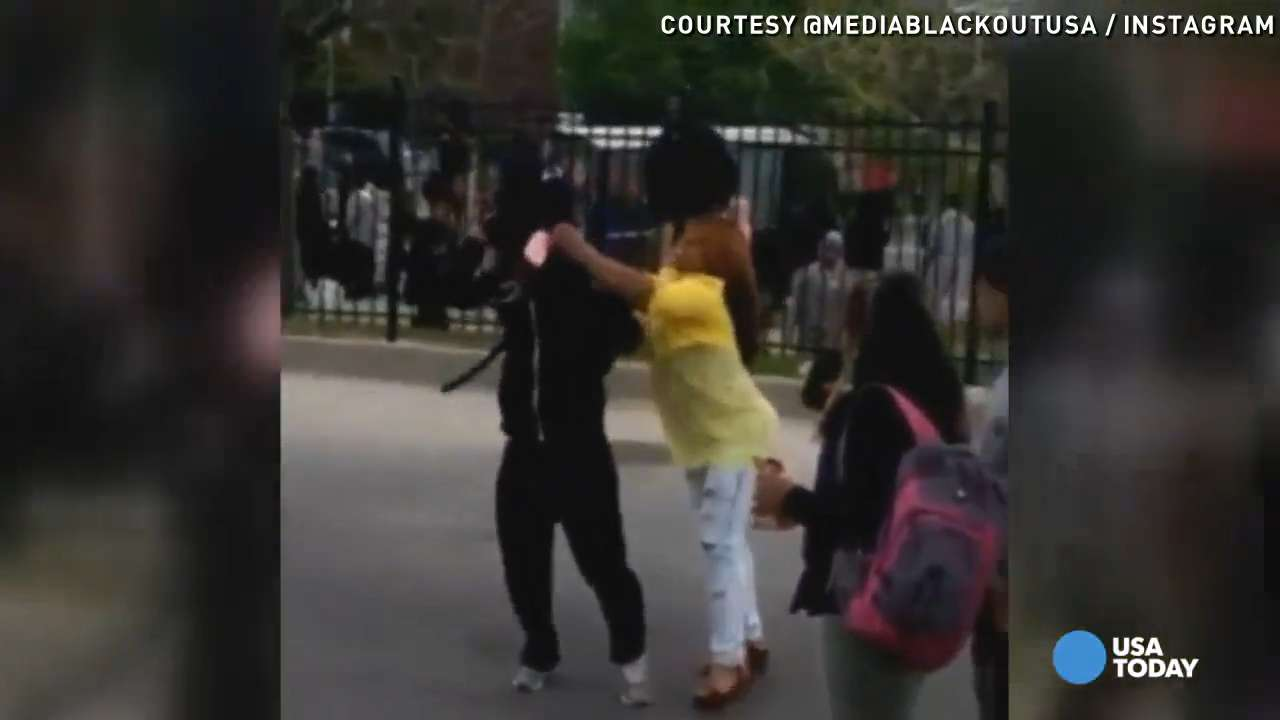 Watch mom snatch masked son from Baltimore protest