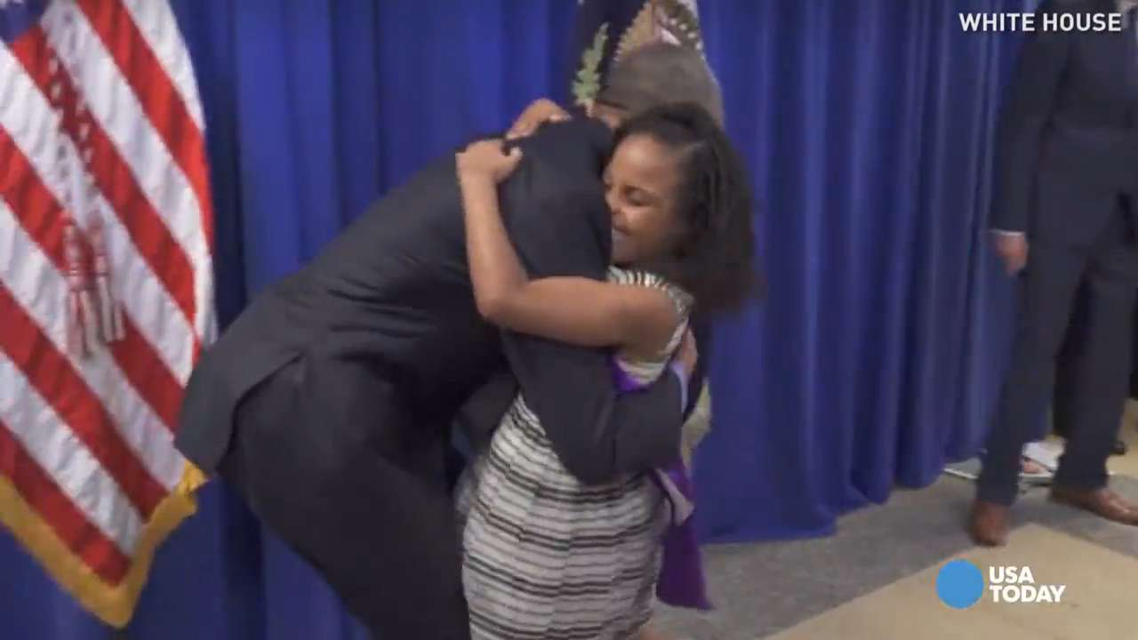 Obama greets 'Little Miss Flint' with massive bear hug