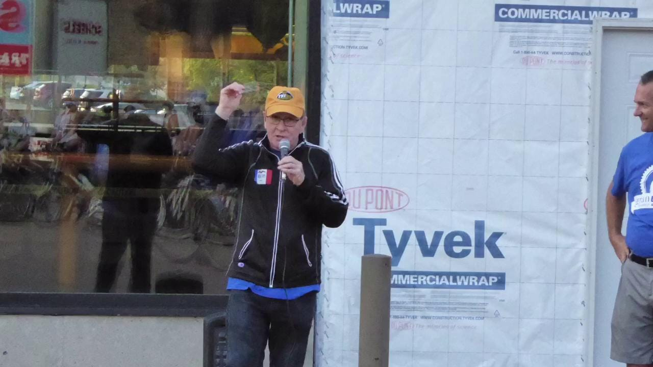 Dan Gable cheers on the riders in the 100-mile countywide ride named in his honor.