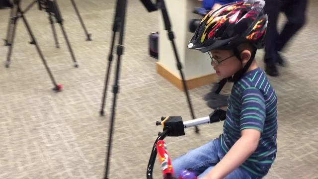 Jonny Cole, who was born missing most of his right arm, was having trouble learning to ride because neither he nor his father could figure out how to keep him balanced long enough to move a bike forward.