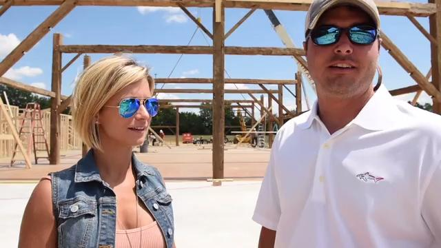 Owners Tori and Nathan Banks talk about the reconstruction of their mid-19th century Canadian barn at a barn raising near Livingston Wednesday.