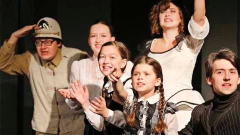"Grace Lorton, 8, is part of the cast for Myers Dinner Theatre's production of ""Chitty, Chitty Bang Bang"" in Hillsboro."