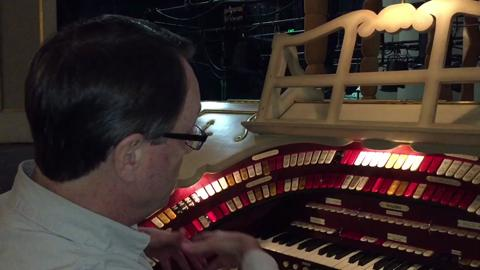 Ken Double, president of the American Theatre Organ Society, explains the reasons behind the keys and switches on the Long Center's Wurlitzer. He will play along with silent comedy Two Tars, a Laurel and Hardy film, on Friday.