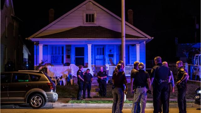Two men were killed and another was injured in a shooting outside a Richmond Avenue home late Friday night.