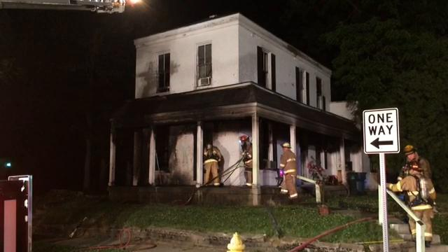 Richmond Fire Department worked to extinguish a fire just after midnight Saturday at the house on the northeast corner of South 11th and South E streets.