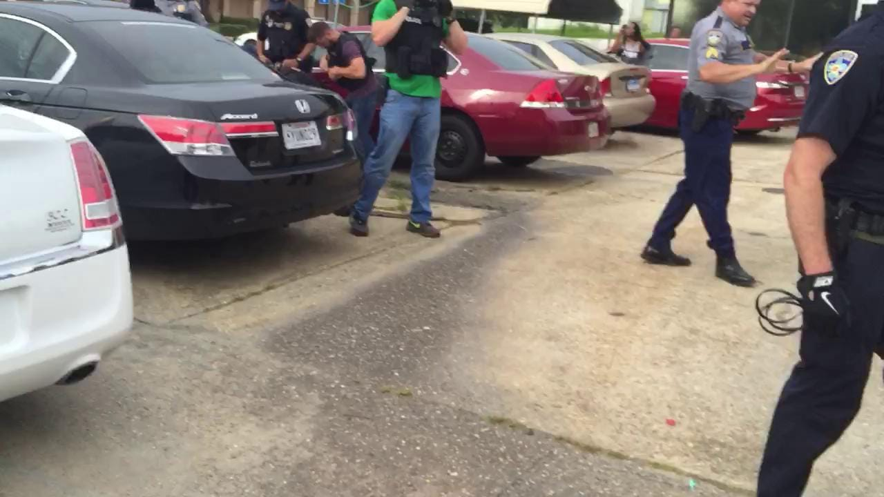Video: Baton Rouge police arrest protester