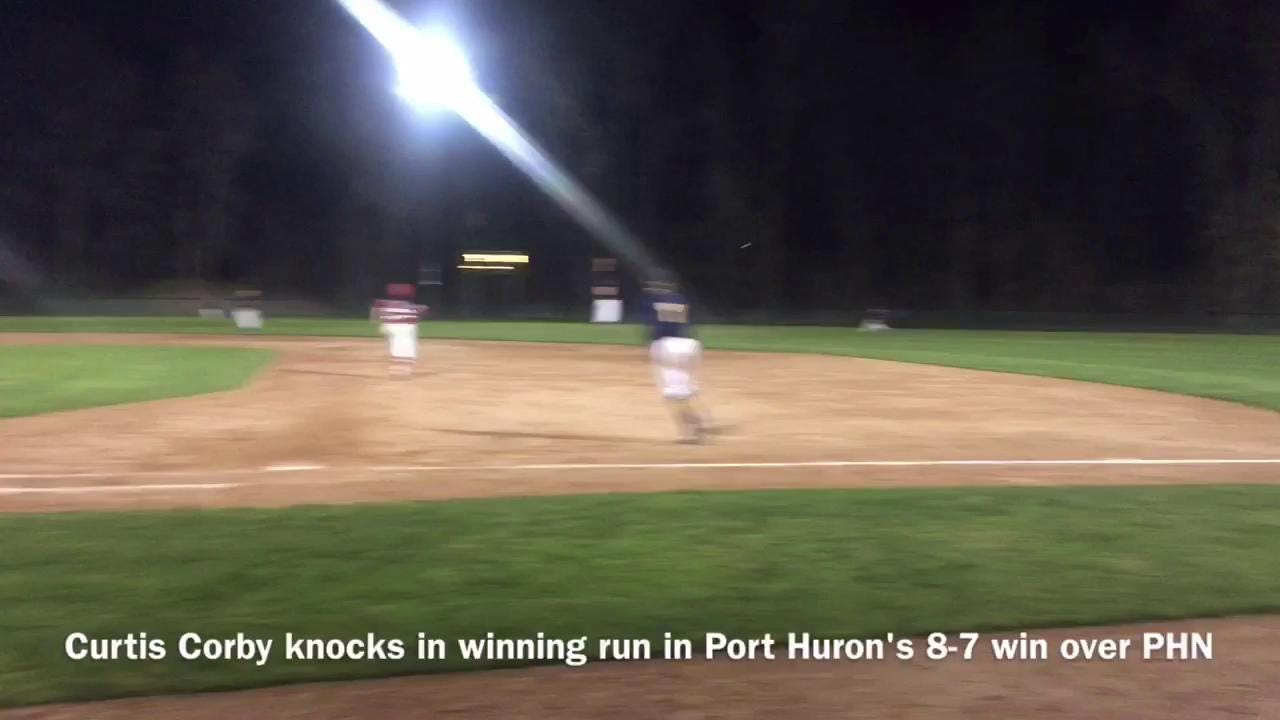 Port Huron's Curtis Corby knocks in the game winning run Friday night at Sanborn Park