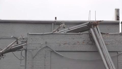 A utility pole caught fire and collapsed onto LynnIvan Salon in downtown Battle Creek Monday.