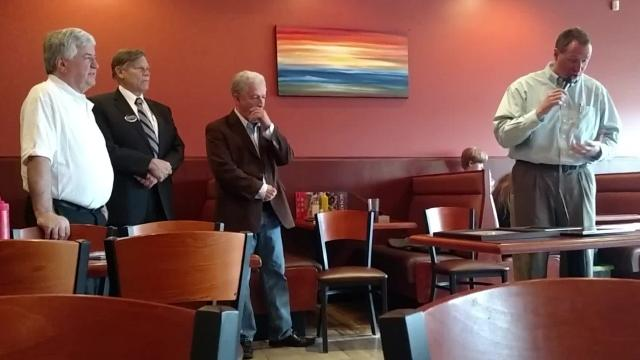 George Dimopoulos, the owner of Senate Coney Island, is honored during a ceremony at his Livonia restaurant earlier this month