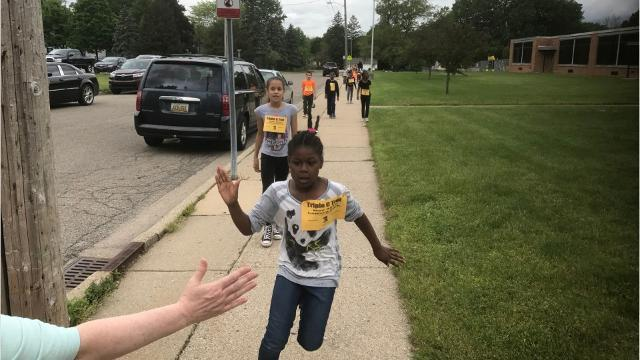 """LaMora Elementary School students learned the value of helping others and staying fit this spring during their school's Triple """"C"""" Trot fundraiser. The """"C"""" stands for Caring Community for Charity. The students collected coins from relatives and frien"""