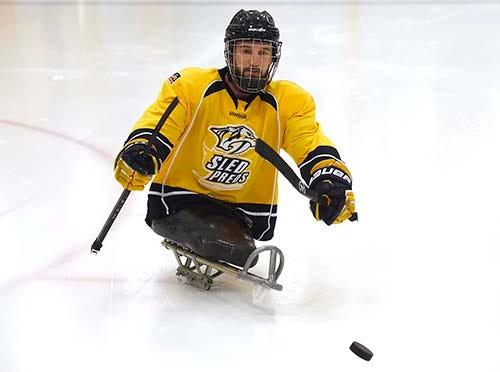 77291289a46 Amputee combat veteran Joey Woodke feels free on the ice