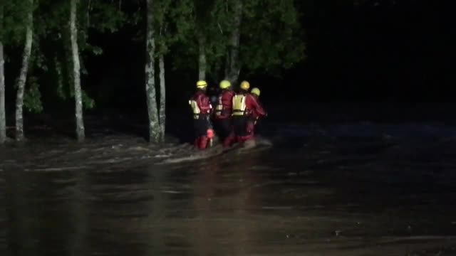 Crews rescue man clinging to tree