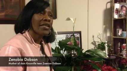 Zenobia Dobson reacts to hearing President Obama recognize her son